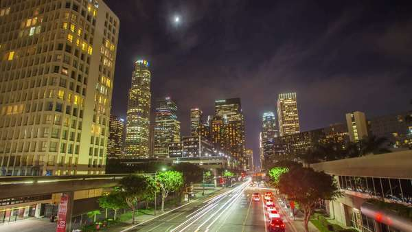 DOWNTOWN, LOS ANGELES, CALIFORNIA, USA - 15 OCTOBER 2014, timelapse on big city freeway traffic shot on a long exposure. Royalty-free stock video