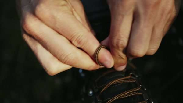 Tying laces of hiking boots Royalty-free stock video