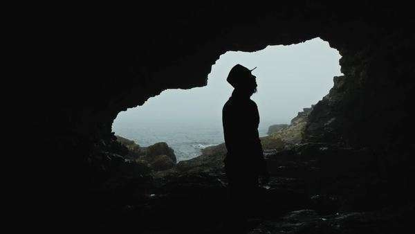 Silhouette of man looking upward in cave Royalty-free stock video
