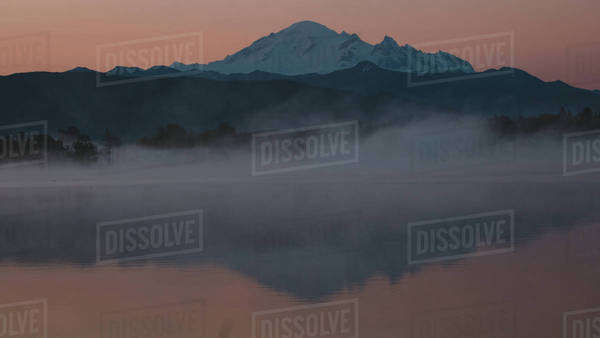 Mountain reflection at sunrise in pond Royalty-free stock photo