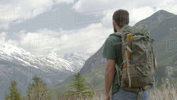 Hiker with backpack in front of mountains Royalty-free stock photo