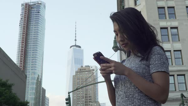 Gimbal shot of a woman using a smartphone Royalty-free stock video