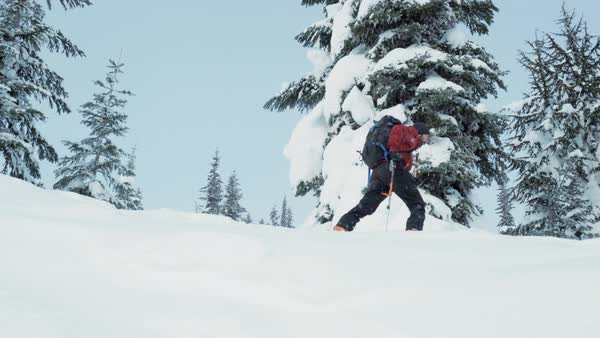 Low-angle shot of a man ski mountaineering Royalty-free stock video