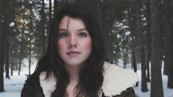Steadicam of a young woman in a winter forest Royalty-free stock video