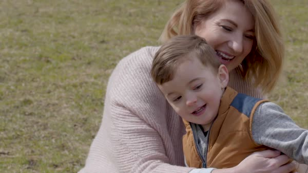 Slow motion shot of a mother hugging her little boy Royalty-free stock video