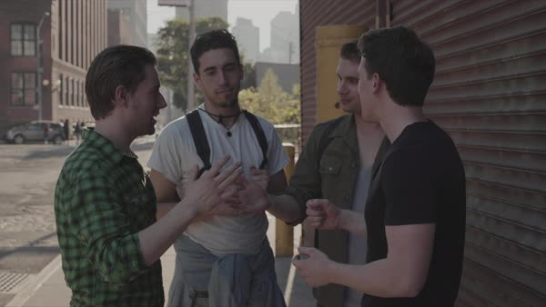 Hand-held shot of four young men laughing outside Royalty-free stock video