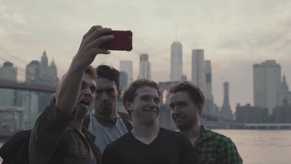 Hand-held shot of young young men taking a selfie in New York Royalty-free stock video