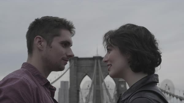 Hand-held shot of a couple looking at each other on Brooklyn Bridge Royalty-free stock video