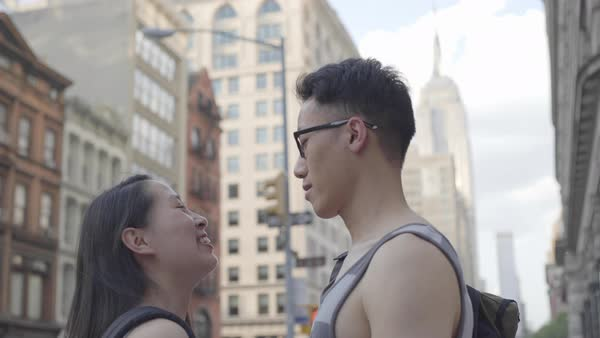 Gimbal shot of a young couple talking on a street in New York City Royalty-free stock video