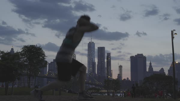 Young man doing lunges with city NYC view as background Royalty-free stock video