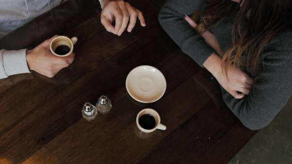 Above angle of coffee cups and hands Royalty-free stock video
