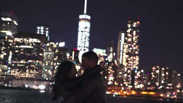 Medium shot of a couple kissing in New York at night Royalty-free stock video