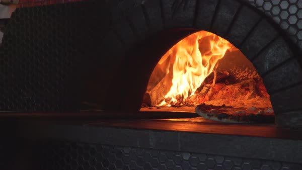 Medium shot of a person baking a pizza in an oven Royalty-free stock video