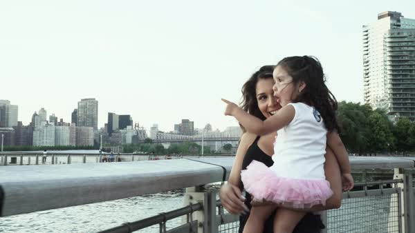 Tracking shot of a mother holding her daughter Royalty-free stock video