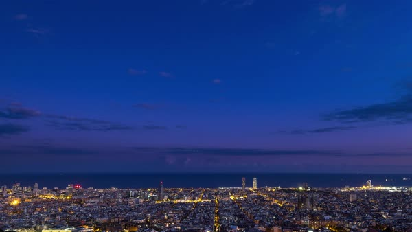 Timelapse of transition from day to night over Barcelona Royalty-free stock video