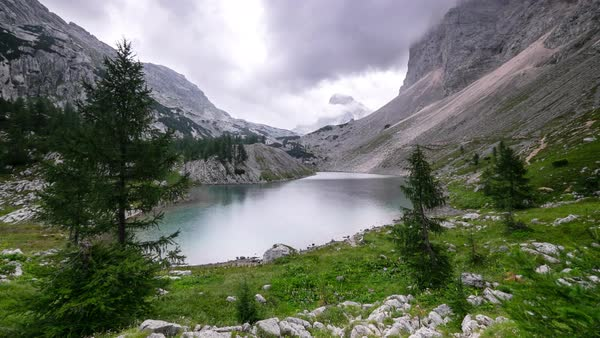 Reflection of cloud movement and mountains on lake surface in the Triglav National Park Royalty-free stock video