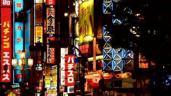 Neon Advertising Signs in the Shinjuku Shopping Ward - Tokyo Japan Royalty-free stock video