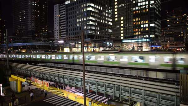 Timelapse of Train Passing over Bridge in Central Tokyo Japan at Night Royalty-free stock video