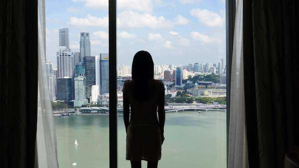 Singapore: Woman with skyline in the background Royalty-free stock video