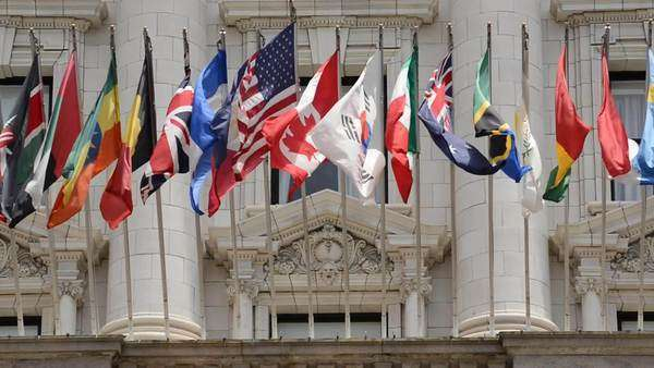 Zoom out international flags fly in the wind Royalty-free stock video