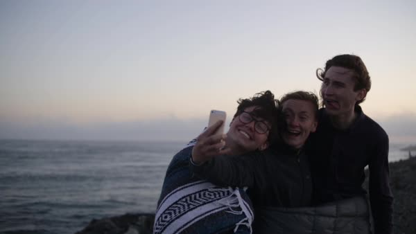 Group Of Fun Friends Take Silly Selfies Together At The Oregon Coast After Sunset (Slow Motion) Royalty-free stock video