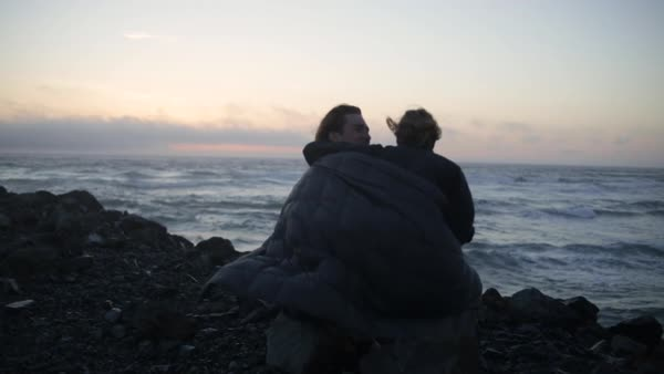 Young Woman Wraps Man In Blanket, They Cuddle And Watch The Sunset Together On The Oregon Coast Royalty-free stock video