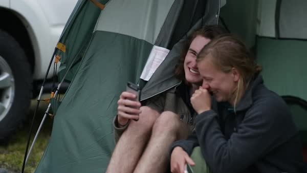 Campers Crack Up Laughing At Something Funny On Smartphone Royalty-free stock video