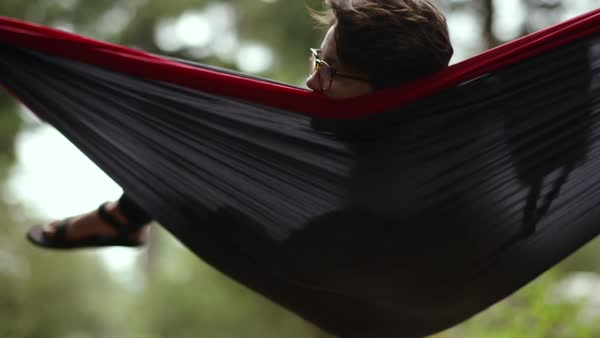 Carefree Camper Relaxes In Hammock, Swings Gently Back And Forth, Slow Motion Royalty-free stock video
