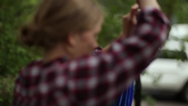 Closeup Of Young Woman Tightening Hammock Strap On Tree (Slow Motion) Royalty-free stock video