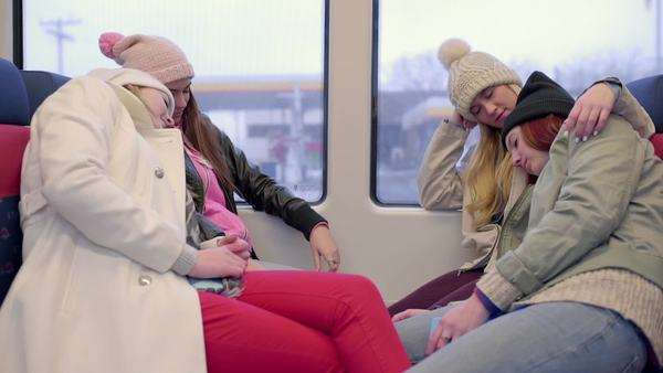 Group of friends, sleeping on a train, in winter (train is still) Royalty-free stock video