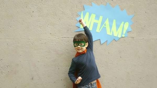 Superhero boy raises his fist to fly and jump Royalty-free stock video