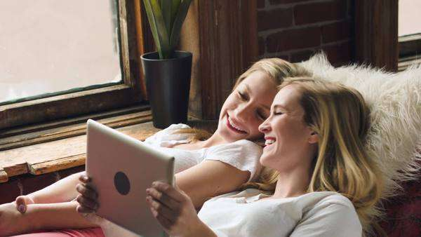 Two Teenage Girls Get Close And Take A Photo Together With Their Tablet Royalty-free stock video