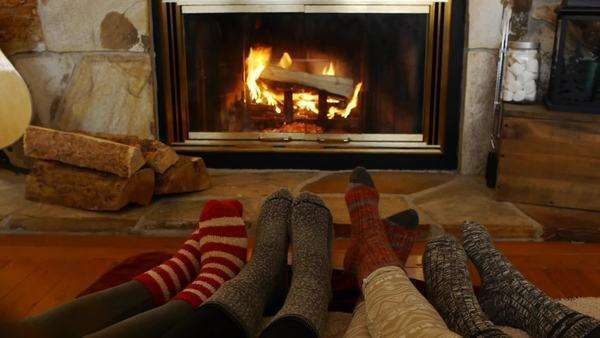 Teen Girls Play Footsie In Front Of A Fireplace Royalty-free stock video