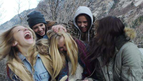 Two Teen Girls Ambushing Friends During An Outdoor Portrait Royalty-free stock video