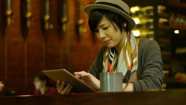 Attractive Young Woman Busy On Her Digital Tablet At A Nice Coffee Shop / Restaurant Royalty-free stock video