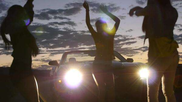 3 Beautiful Girls Dance In Convertible's Headlights Royalty-free stock video