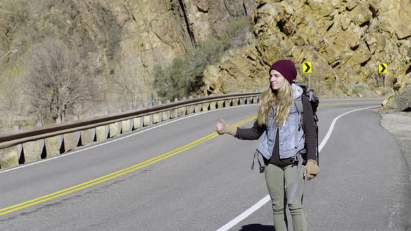Female Backpacker Hitchhikes In Utah, Car Pulls Over For Her (License Plate Blurred Out) Royalty-free stock video