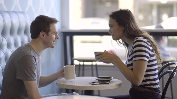 Happy Couple Enjoy Coffee, They Cheers And Share A Cute Moment Together Royalty-free stock video