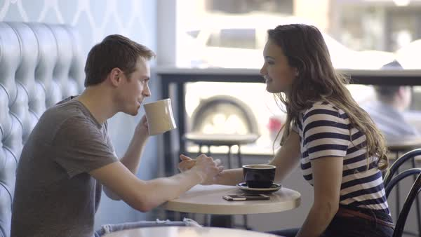 Happy Couple Hold Hands, Flirt/Laugh At Coffee Shop Royalty-free stock video