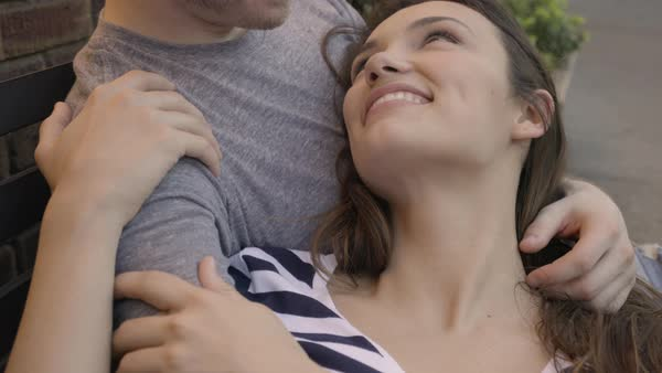 Closeup Of Couple Cuddling On A Bench Outside Of Restaurant Royalty-free stock video