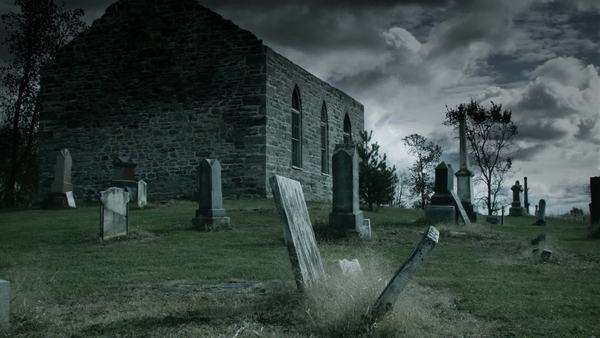 Toned timelapse of a very dark and sullenabandoned church and cemetery on a moody cloudy day Royalty-free stock video