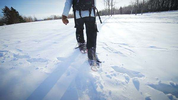 Epic Closeup of Woman Snowshoeing on a Beautiful Winter Day Royalty-free stock video
