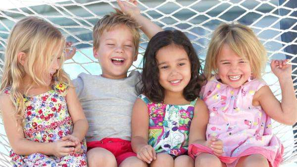 Group of 4 children relax together in hammock. Royalty-free stock video