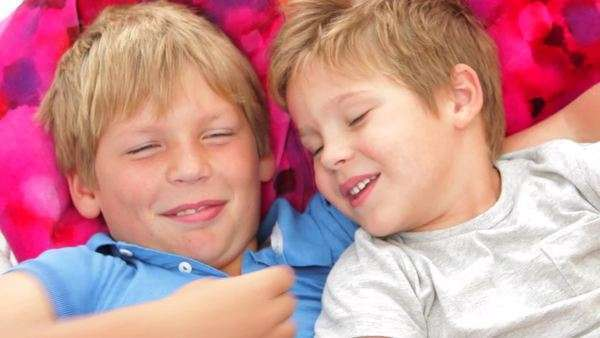 Two boys relax together in hammock. Royalty-free stock video