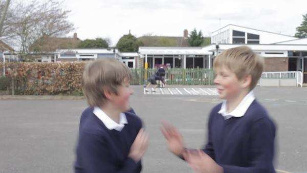 Two boys punching one another in playground fight. Royalty-free stock video