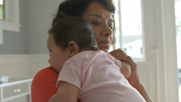 Grandmother holding baby granddaughter Royalty-free stock video