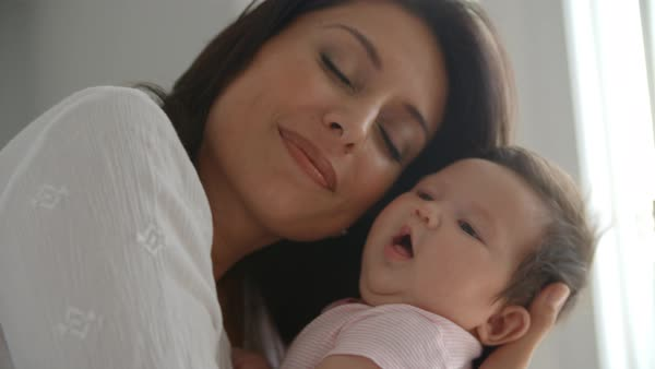 Mother holding newborn baby daughter Royalty-free stock video