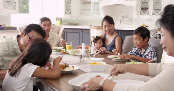 Extended family group eating meal at home Royalty-free stock video