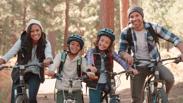 Family sitting on bikes in forest, close up Royalty-free stock video