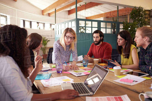 Female manager leads brainstorming meeting in design office Royalty-free stock photo